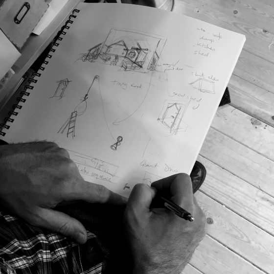 Mark sketches a storyboard for The Dinosaur That Came For Christmas