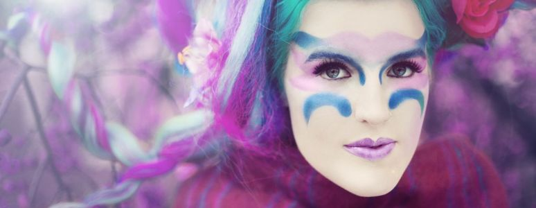 Singer songwriter Lucy Ward in exotic make up and blue hair