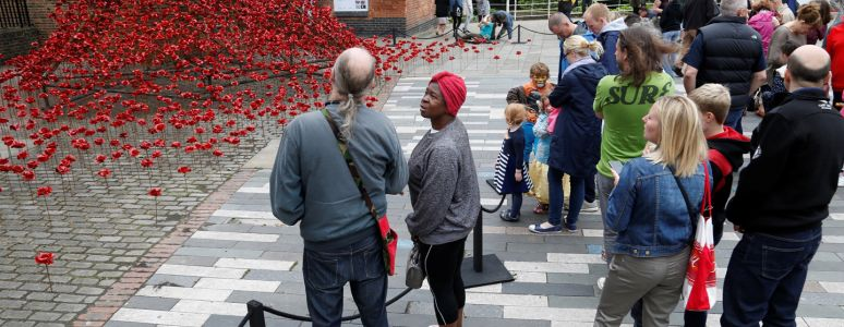 Poppies: Weeping Window sculpture with visitors