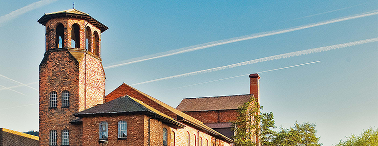 Photograph of Derby Silk Mill against a blue sky