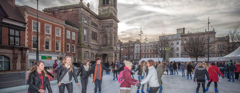 Skaters on the ice rink in Derby Market Place